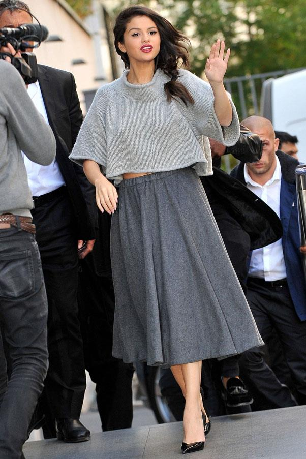 <strong>September 28, 2015</strong> <br><br> Selena wore all-grey in an oversized crop top and midi skirt from CO Fall 2015 collection.