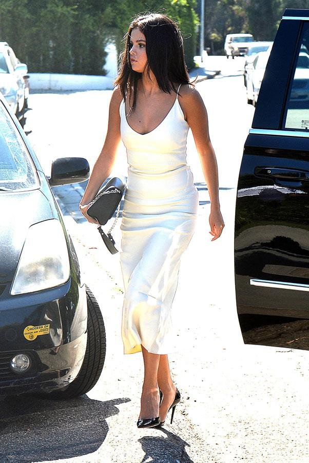 <strong>August 16, 2015</strong> <br><br> Selena looked bright in an Atea Oceanie dress.