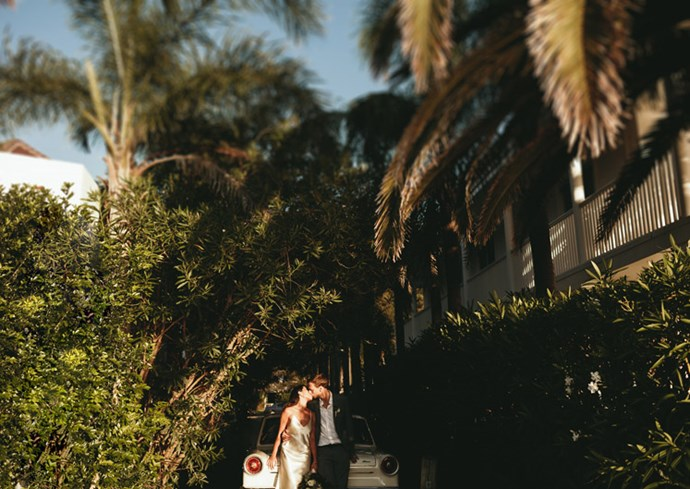 <strong>On their vision for the day:</strong> <br><br> Having grown up in Singapore I've always loved palms and orchids so our theme was loosely based on 'Frank Sinatra throws a party in the Hollywood hills, with a tropical touch.' We wanted it to feel intimate and fun for our family and friends and to make the most of the beautiful venue. With the ceremony taking place outside, the vision definitely involved sunshine!