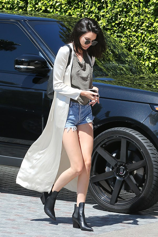<strong>July 18, 2016</strong> <br><br> Kendall stepped out in Beverley Hills wearing a silk cardigan over a worn tee and RE/DONE cut-off shorts. She finished the look with rounded sunnies and a leather backpack.