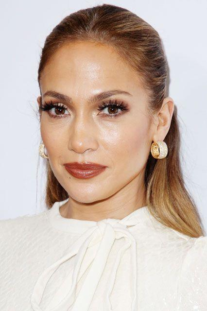 Her beauty looks remained bold, opting for clumped lashes, big brows and brown glossy lipstick.