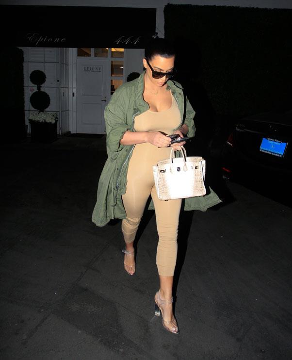 In a Yeezy Season 3 nude bodysuit and khaki coat, March 2016