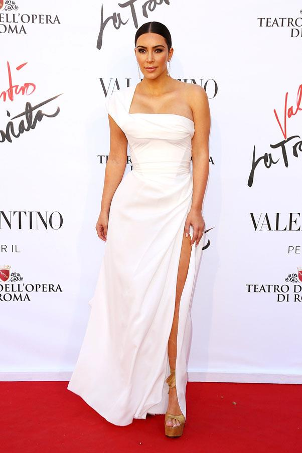 Wearing a white thigh-cut gown for Rome's 'La Traviata' premiere, May 2016
