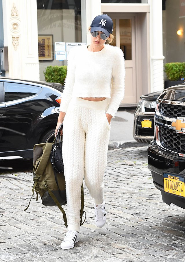 Gigi stuck to a beige colour palette but played with textures - paired with her staple Adidas Superstars - out in New York.