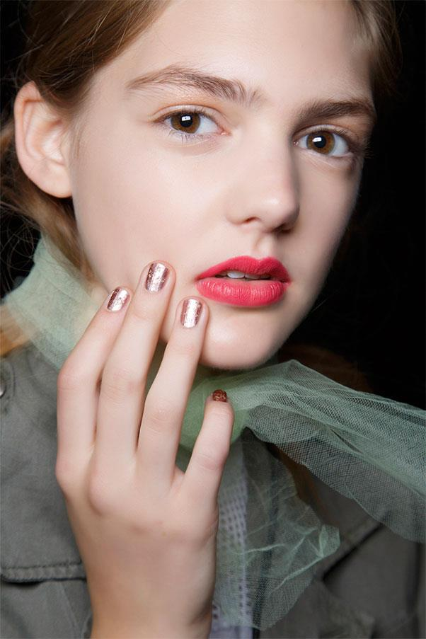 <strong>Mottled Mirror</strong><br><br> For the dimensional metallics at Badgley Mischka, manicurist Deborah Lippmann topped chrome blush with a metallic gold shade.