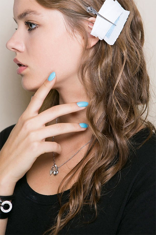 <strong>Matte Powder Blue</strong><br><br> At Au Jour Le Jour, models wore three shades—powder blue, canary yellow, and hot coral. On some looks, white polish was drizzled upwards from the cuticle.