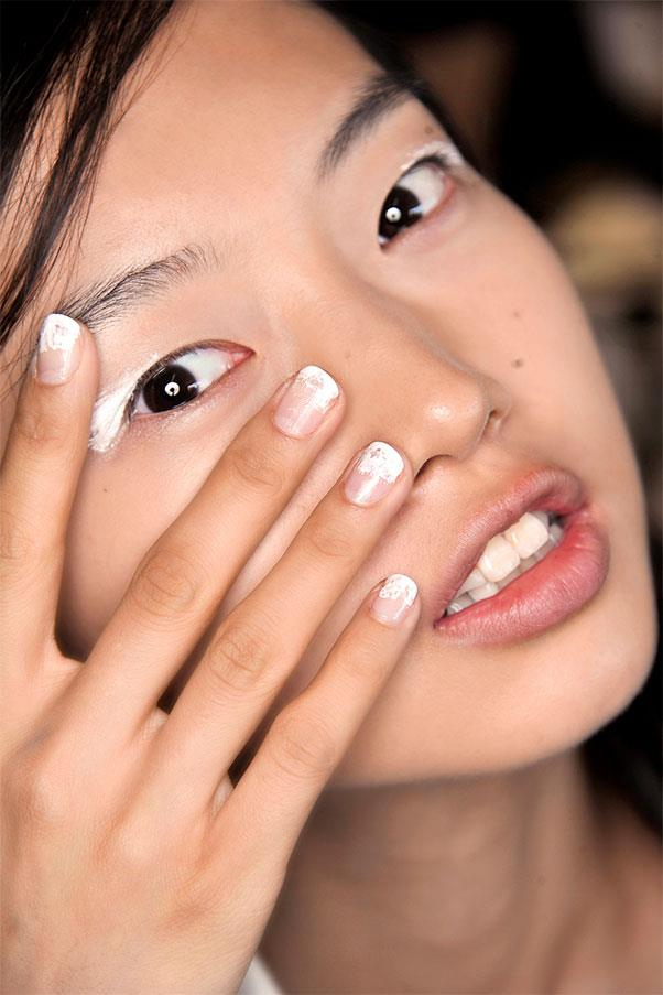 <strong>Scuffed White Tips</strong><br><br> Precise French manis had no place at Zero + Maria Cornejo, where lacquer was cross-hatched messily on the top third of the nail.