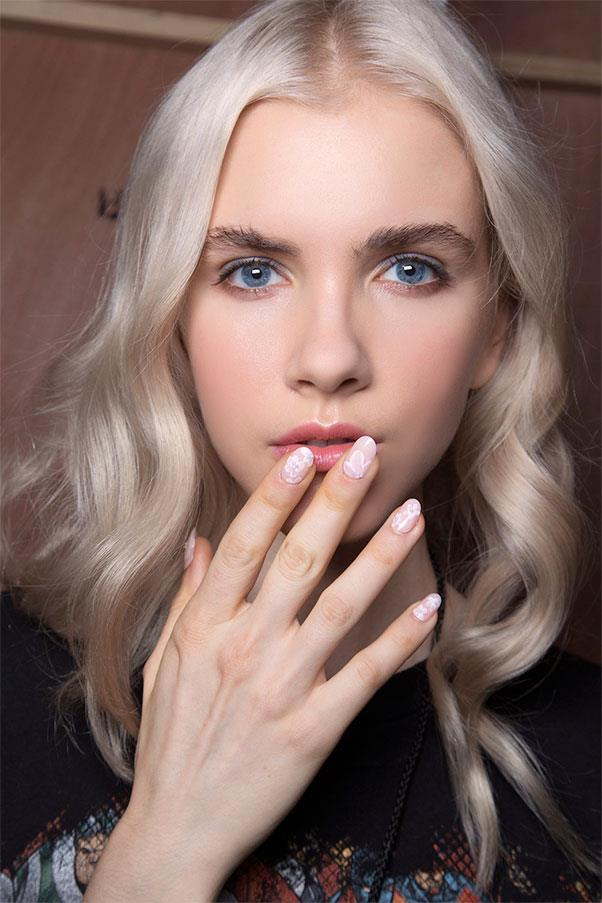 <strong>Fancy Florals</strong><br><br> Miss Pop worked with KISS at Erin Fetherston, starting with a petal pink base coat, then she used an itty-bitty paintbrush to draw white flowers on top.