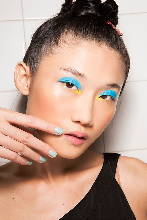 <strong>Sea Change</strong><br><br> At Isola Marras, manicurist Antonio Sacripante topped aqua polish with a matte contrast as a meta-take on sea-hued nails.