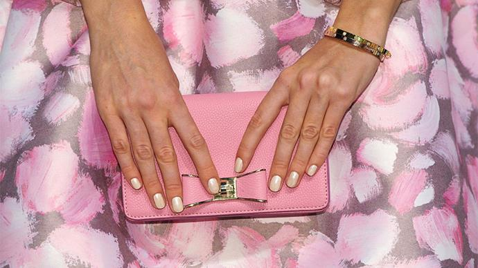 <strong>Better Beige</strong><br><br> Nude nails get a bit more glam when they're topped with a slightly glinty, luminescnet top coat at Kate Spade.