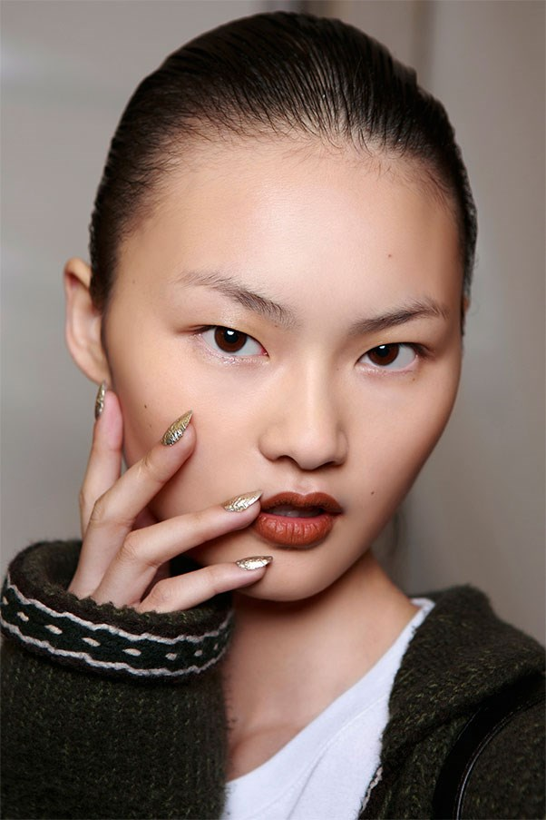 <strong>Mixed Metals</strong><br><br> The gold and silver flecked nails at Kenzo will look hot with a bikini, and cool with a chunky sweater.