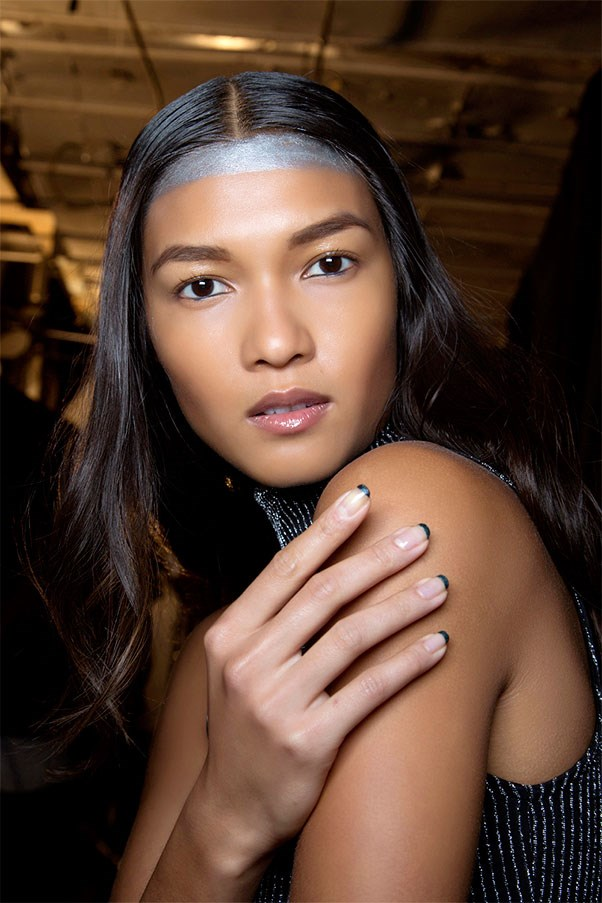 <strong>Lean Green</strong><br><br> Maybe full-on emerald nails sound like a little much. Do as they did at Francesca Liberatore and paint just the skinniest streaks along your tips.