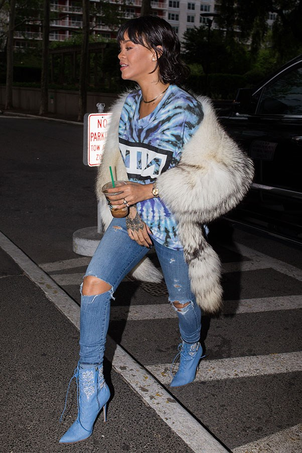 <strong>When:</strong> May 24th, 2016<br><br> <strong>What:</strong> In a vintage 'Nine Inch Nails' tee, Rihanna for Manolo Blahnik boots, ripped jeans and a fur stole.