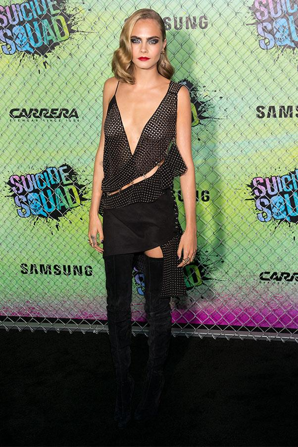 <strong>August 2nd, 2016</strong><br><br> Cara opted for a risque Anthony Vaccarello dress and thigh-high suede boots by Christian Louboutin for the world premiere of <em>Suicide Squad</em> in New York.