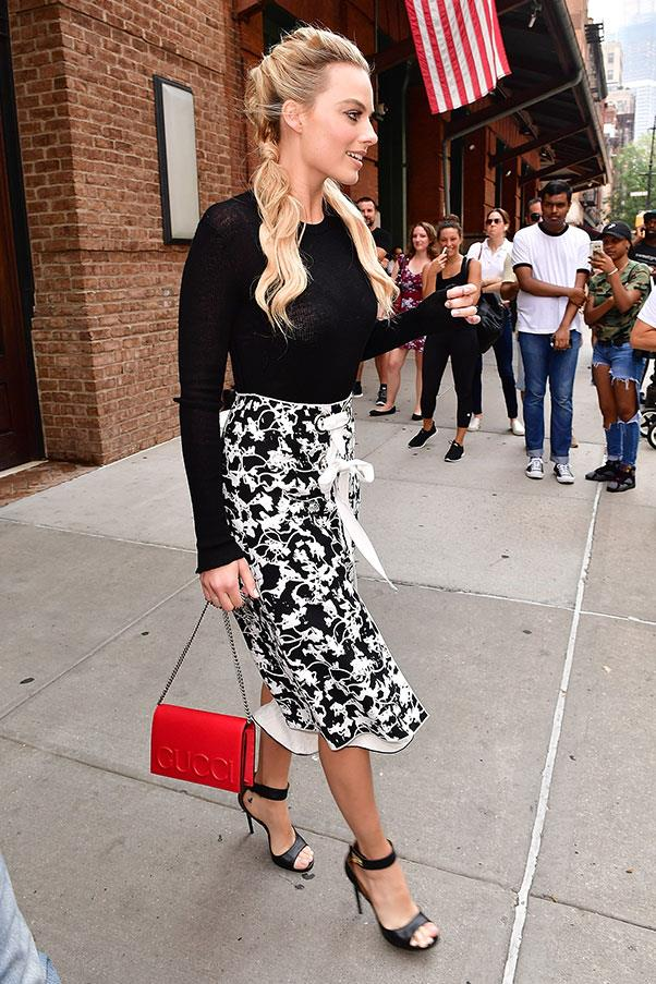 <strong>July 30th, 2016</strong><br><br> Margot opted for a floral print, paired with a red Gucci handbag, while on a junket in New York.
