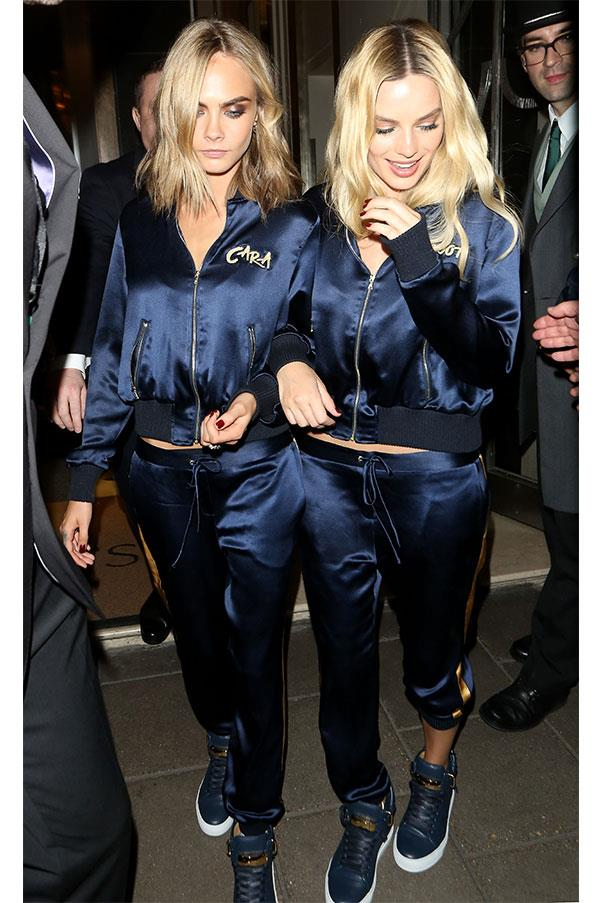 Cara and Margot wore amazing, matching personalised track suits to the Suicide Squad European premiere after party in London, paired with Buscemi high-tops. <br><br> Image: Splash
