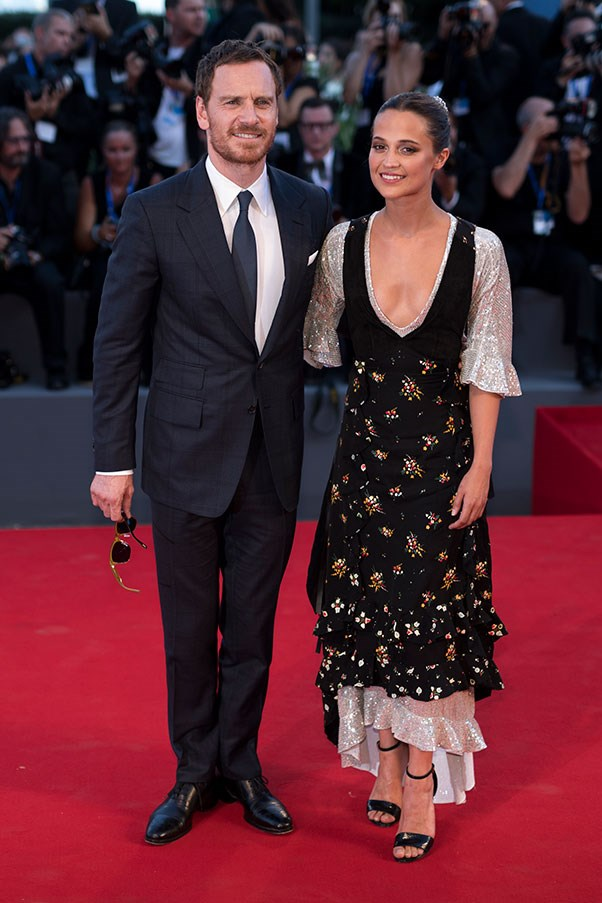 Michael Fassbender and Alicia Vikander in Louis Vuitton at the premiere of <em>The Light Between Two Oceans</em>