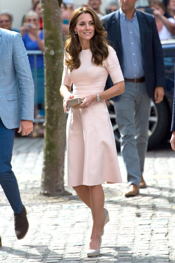 "Kate stepped out in Cornwall wearing a (<a href=""http://www.harpersbazaar.com.au/fashion/trending-now/2016/8/rose-quartz-colour-fashion-trend/"">very on trend</a>) rose quartz dress, designed by Lela Rose. She finished the look with a box clutch and espadrille wedges."