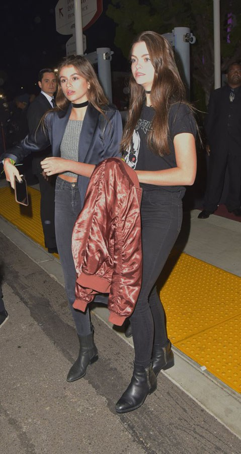 <strong>May 6, 2016</strong> <br><br> Kaia wore a thick choker, crop and duster jacket à la Kendall Jenner when out at dinner. <br><br> Image: Splash
