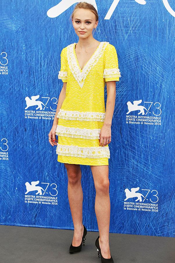 In an embroidered yellow dress by Chanel at the 2016 Venice Film Festival