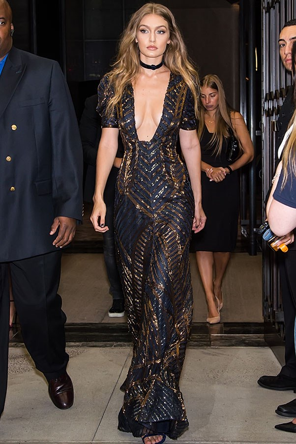 <strong>Day 2</strong> <br><br> Gigi en-route to the Fashion Media Awards in this plunging dress by Hilfiger Collection.