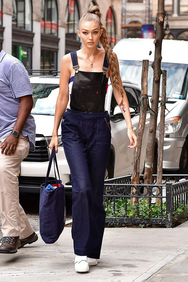 <strong>Day 4:</strong> <br><br> Gigi rocks a pair of overalls with a slicked Rapunzel-do.