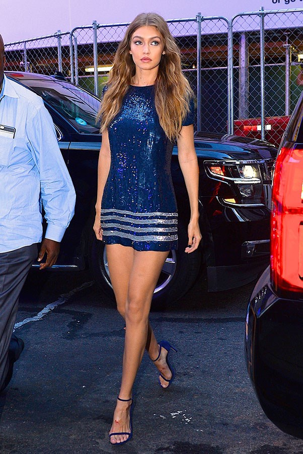 <strong>Day 3:</strong> <br><br> Gigi with legs for days in this sequined mini dress.