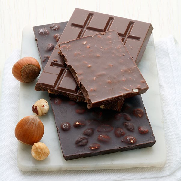 """<strong>Dark Chocolate</strong> <br><br> Chocolate has even been referred to as """"the new anti-anxiety drug."""" It contains a number of potentially psychoactive chemicals such as anandamines which stimulate the brains in a way that it temporarily blocks feelings of pain and depression, tyramine and phenylethylamine which have similar effects as amphetamine, and theobromine and caffeine which act as stimulants. Nevertheless, these substances are present in chocolate in very low concentrations. Choose a dark chocolate (less than 70 per cent cacao) to also get the antioxidant health benefits of cacao, and limit consumption to two squares per day."""