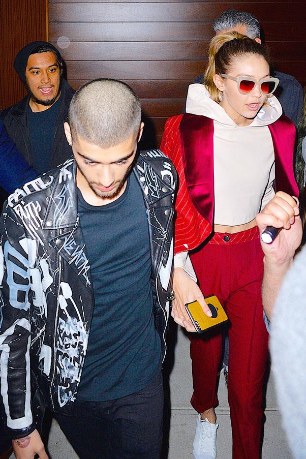 <strong>When:</strong> May, 2016<br> <strong>What:</strong> Gigi rocks a red satin-lined suit with a hoodie (literally nobody else could pull this off) while Zayn opts for a graffiti-ed leather jacket.