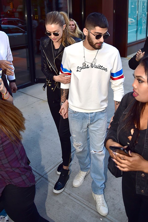 <strong>When:</strong> June, 2016<br> <strong>What:</strong> Gigi keeps it simple in head-to-toe black while Zayn rocks a Louis Vuitton jumper and ripped denim.