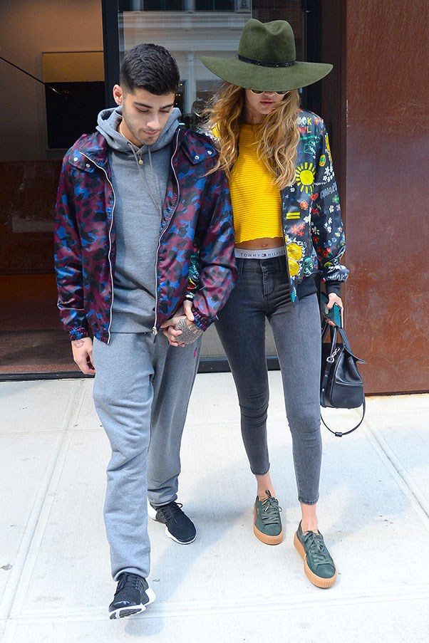 <strong>When:</strong> July, 2016<br> <strong>What:</strong> Gigi makes a rare foray into colour with this embellished bomber x yellow shirt combo (note the Fenty Puma by Rihanna creepers!) while Zayn pulls off the unlikely combination of a grey tracksuit and a camo-inspired silk jacket.