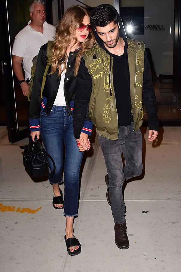 <strong>When:</strong> July, 2016<br> <strong>What:</strong> Gigi keeps it classic in pool slides and a Tommy Hilfiger varsity jacket while Zayn sticks to his token graffiti-ed outerwear.