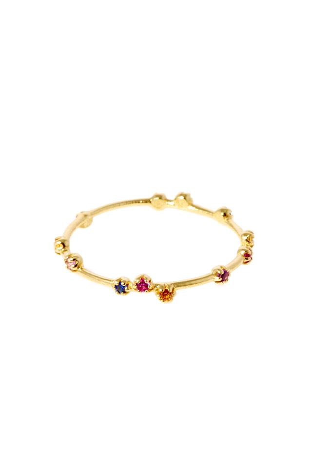 """Ring, $890, <a href=""""https://www.sarahandsebastian.com/collections/women/products/tiny-stone-ring-gold"""">Sarah & Sebastian</a>"""