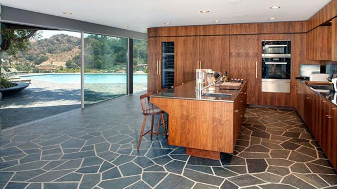 More open spaces as the kitchen leads out to the luxurious pool.