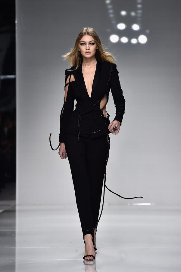 <strong>5. Gigi Hadid: The Authority</strong> <br><br> She might appear to be the Californian 'girl next door' smiling with Taylor's squad and enjoying nights in with her boyfriend Zayn Malik on Instagram but on the catwalk, Gigi is a force to be reckoned with. Gigi's slightly tilted forward shoulders and soft movement on the catwalk shows everyone who is boss. <br><br> <em>Versace Haute Couture Spring/Summer 2016</em>