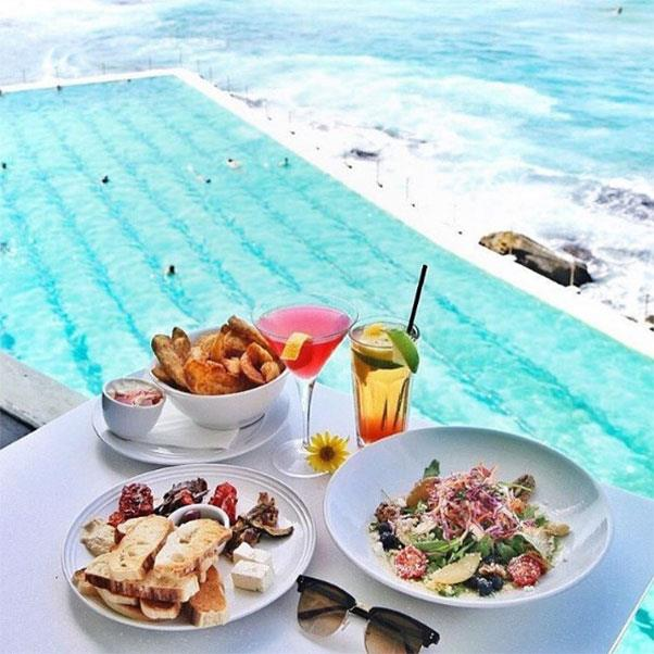 """<strong><a href=""""http://icebergs.com.au/"""">Bondi Icebergs</a></strong> <br><br> <strong>Location:</strong> Bondi, NSW <br><br> Sydney's iconic Bondi icebergs is the perfect summer escape. Its incredible view, situated just over it's famous pools, is only the start for this local favourite, as the restaurant's fresh, local produce is another highlight. <br><br> <a href=""""https://www.instagram.com/bondiicebergs/"""">@bondiicebergs</a>"""