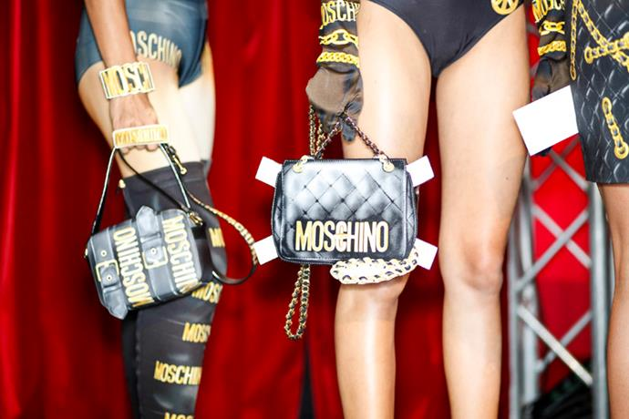 <strong>Backstage</strong> <br><br> The classic black and gold Moschino bag has been re-imagined this season.