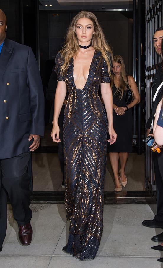 On her way to the Daily Front Row Fashion Media Awards, Gigi wore a plunging Tommy Hilfiger gown, Stuart Weitzman heeled sandals and a velvety choker.