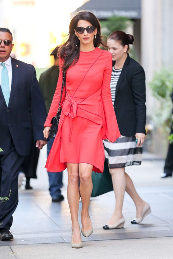 <strong>What:</strong> A bright long-sleeved dress with a tie at the waist and black leather bag, both by Proenza Schouler, nude pointed-toe pumps and oversized sunglasses <br><br> <strong>When:</strong> September 22, 2016 <br><br> <strong>Where:</strong> In NYC