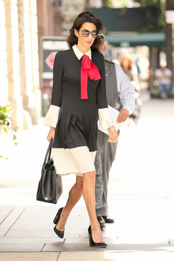 <strong>What: </strong>A chic black Gucci dress with a red pussy bow, pleated skirt and white bell sleeves, hem and collar; paired with block-heeled black pumps, a black leather tote and oversized sunglasses <br><br> <strong>When</strong>: September 21, 2016 <br><br> <strong>Where:</strong> Out in NYC