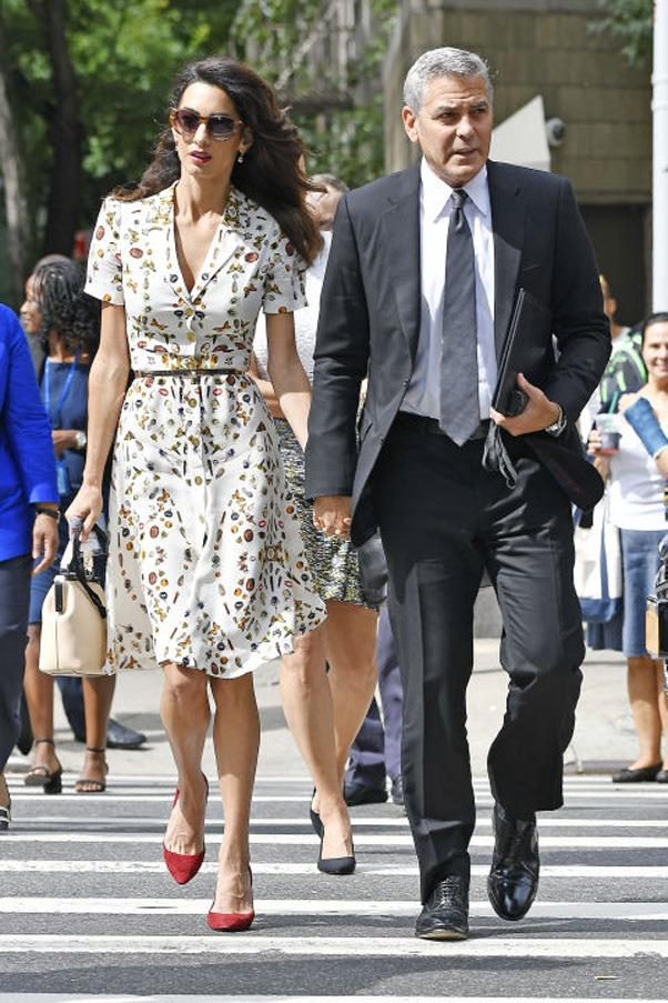 <strong>What:</strong> An Alexander McQueen printed shirtdress (like the one <strong>Kate Middleton</strong> wore to Wimbledon) with a thin belt, red pointed-toe pumps, a cream colored handbag and oversized sunglasses <br><br> <strong>When:</strong> September 20, 2016 <br><br> <strong>Where:</strong> Walking to the United Nations headquarters with George Clooney