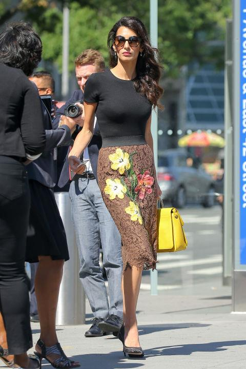<strong>What:</strong> A black t-shirt, brown embroidered lace skirt, black pumps, oversized sunglasses and a bright yellow handbag. <br><br> <strong>When:</strong> September 28, 2016 <br><br> <strong>Where:</strong> Out in NYC