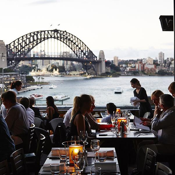 """<strong><a href=""""http://cafesydney.com/"""">Café Sydney</a></a></strong> <br><br> <strong>Location:</strong> Circular Quay <br><br> Another iconic Sydney venue, this restaurant has one of the best views of the harbour of any restaurant in the city. The fare, with its modern Australian touches, is excellent too. <br><br> <a href=""""https://www.instagram.com/cafesydney/"""">@cafesydney</a>"""