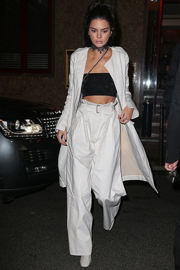 <strong>October 1, 2016</strong> <br><br> Kendall Jenner stepped out at Paris fashion week in head-to-toe Bianca Spender, wearing the Australian label's white denim coat and pant ensemble.