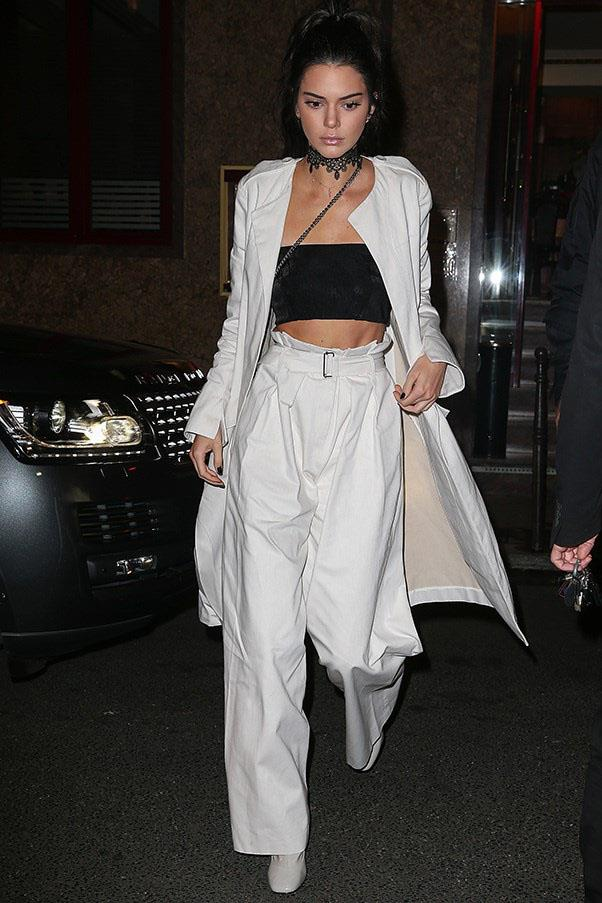 "<strong>Bianca Spender</strong> <br><br> Kendall wore the Bianca Spender white denim coat and pant ensemble at Paris fashion week. <br><br> Shop the look <a href=""http://www.biancaspender.com/shop/shop-runway/163530/White-Denim-Coat.html"">here</a>."