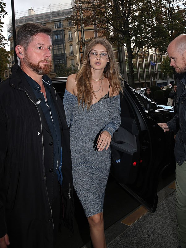 """<strong>C/MEO Collective</strong> <br><br> Gigi wore C/MEO Collective's 'Make A Move' knit dress in at Paris fashion week. <br><br> Shop similar <a href=""""http://fashionbunker.com/label/c-meo-collective?dir=desc&order=sort_date"""">here</a>."""