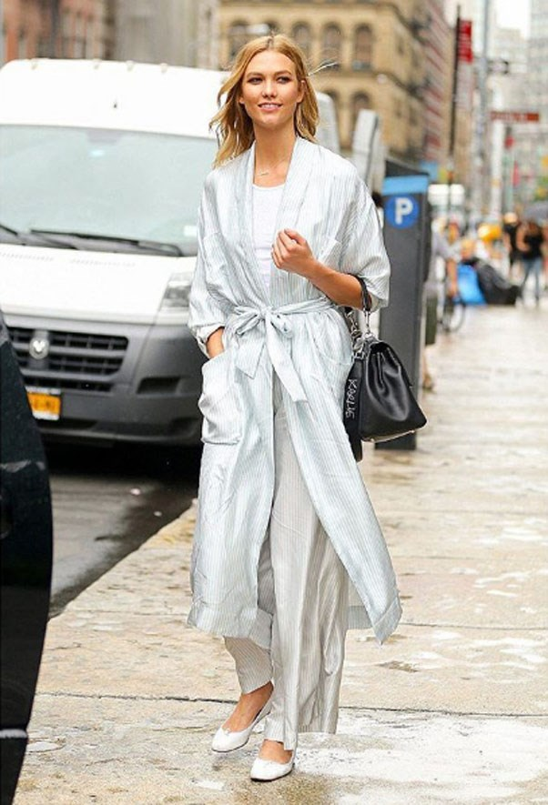 """<strong>Zimmermann</strong> <br><br> Karlie Kloss wore the two piece striped robe and palazzo set from their new ready to wear collection in New York. <br><br> Shop the look <a href=""""https://www.zimmermannwear.com/new-arrivals/winsome-robe-sky-pearl.html"""">here</a>. <br><br> Instagram: <a href=""""https://www.instagram.com/p/BHtppF7gBNP/?hl=en"""">@zimmermann</a>"""