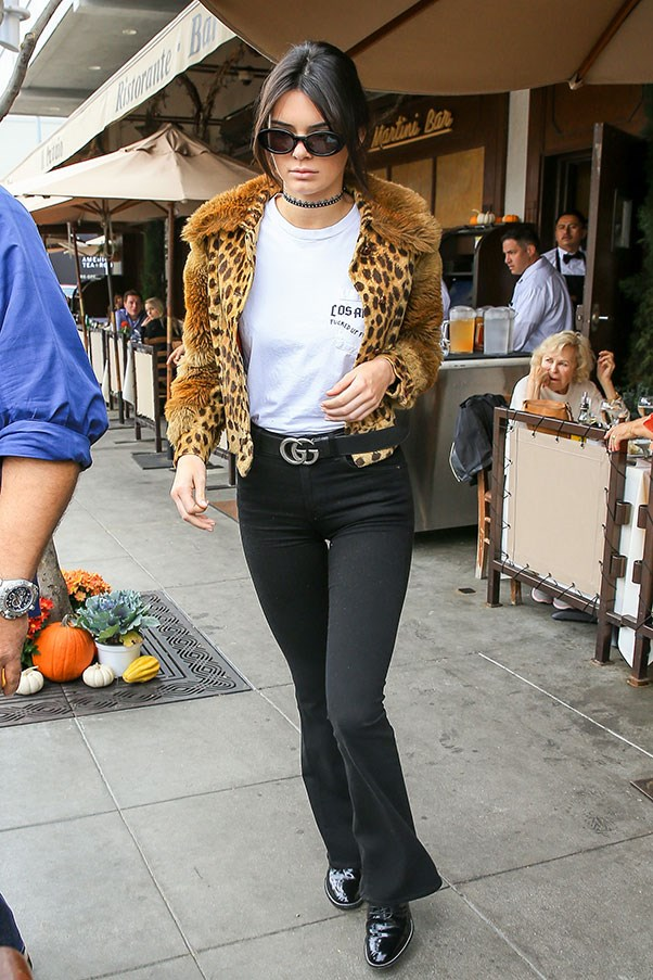 Jenner made her first public appearance since the Paris robbery, stepping out to lunch with sister Kourtney's ex Scott Disick. She wore a leopard print fur jacket over a white tee, high-waisted dark wash flared jeans, a Gucci belt, black patent leather booties, rounded sunglasses and a jeweled choker.