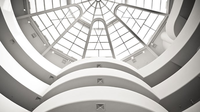 <strong>The Guggenheim Museum</strong> <br><br> At the height of his architectural fame, Frank Lloyd Wright designed the masterpiece that is the Guggenheim museum. Wind your way up the levels of the massive rotunda to the exhibitions and halls that showcase world-class art dating from the 19th century to the present — all illuminated from above by the massive central skylight.