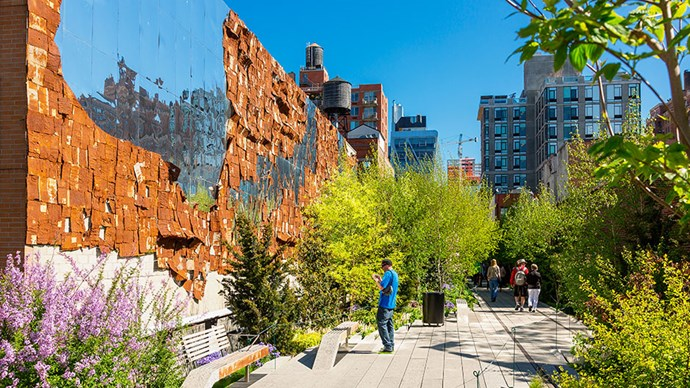 <strong>The High Line</strong> <br><br> Modelled after La Promenade Plantée in Paris, the High Line is a mile-long elevated public park built on abandoned railway tracks that runs along 10th Avenue between the Meatpacking District and the West 30s. The path is punctuated with art installations and stop-offs for food, and the views of the Hudson River are spectacular — especially at sunset.
